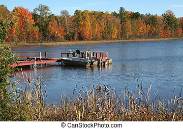 SCENIC AUTUMN - Boats in a small lake during autumn time