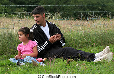 Time Together - Man and a little girl sitting together on...