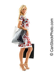 shopping lady - lovely blond with shopping bags over white