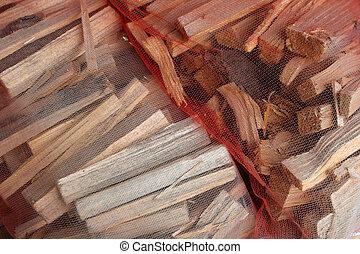 Kindling for Fires - Cut firewood kindling in a net bag...