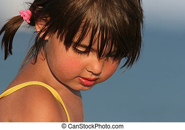 Beautiful Child - Face of a little girl with sand on her...