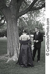 Prom Preparation - Beautiful young girl getting help...
