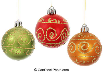 Three Baubles - Three Christmas baubles hanging over white...
