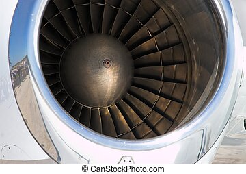 Engine Blades - Close up of the fan blades inside a jet...