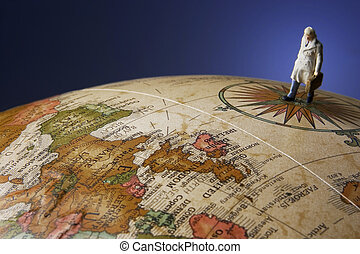 globetrotter - Business figurine placed with antique earth...