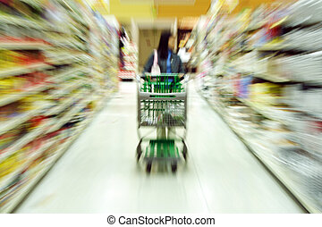 Grocery shopping - A woman shopping in a grocery...