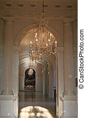 Luxurious Interiors - Sun light falling on chandeliers in a...