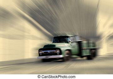 Old truck motion blu - Concept of old truck in motion blur