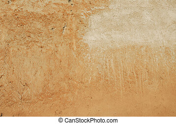 wall splat - textured ochre colored wall in rome with subtle...