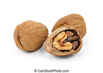 walnuts - three walnuts with white background