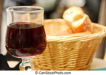 Wine and bread - Glass of young red wine and fresh bread