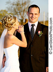 Bride Groom - Bride resting her hands on her grooms shoulder