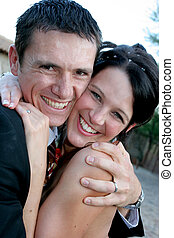 Couple Squeeze - A groom and bride squeezing each other...