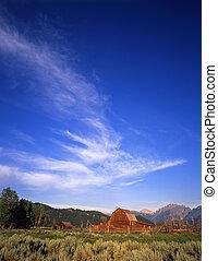 TetonRanch#3 - A barn, corral and part of the Teton Mountain...