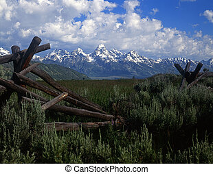 Tetons&Fence#4 - A buck and rail fence and the Teton...