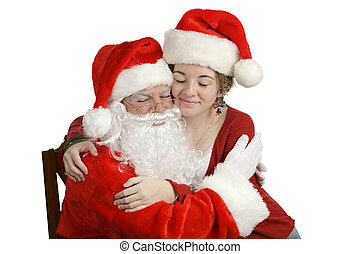 A Hug For Santa - A girl sitting on Santa\\\'s lap and...