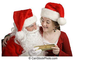 Thank You Santa! - A girl receiving a gift from Santa Claus....