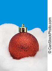 Red Christmas ball - Single red Christmas ball lying on a...