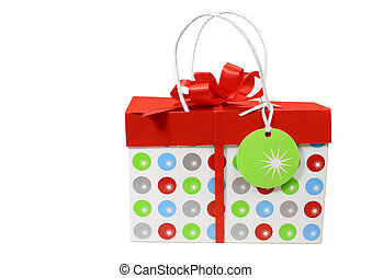 Holiday Package - Holiday gift box with bow and blank tag on...