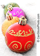 Baubles - Line of bright Christmas baubles with pale...