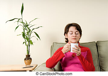 Clam - calm woman drinking from a white cup