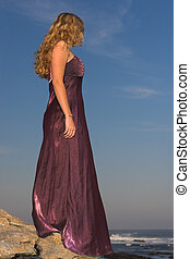 Lonesome - Girl in purple dress at the beach