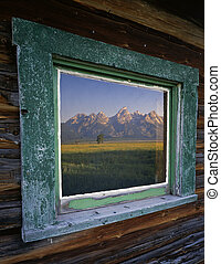 Tetons and Window - The Teton Mountain Range reflecting in...