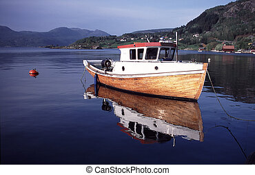 evening atmosphere - boat in a little harbor in norway