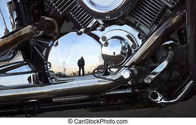 Motorcycle  - Part of a motorcycle with reflections