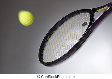 tennis racket hitting the yellow ball cose up