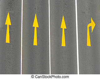 Road Markings - Direction arrows on a road from above.
