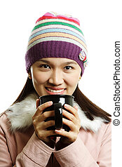 Drinking - A beautiful girl holding a cup of hot drink