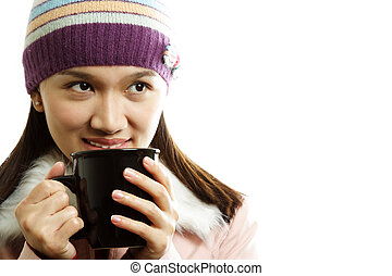 Drinking - A beautiful girl wearing winter dress holding a...