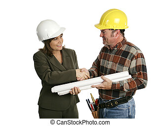 Architect & worker - A female architect or engineer meeting...
