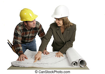 Going Over Blueprints Together - A female engineer going...