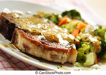 Pork chop - A pan fried pork chop with vegetables and...