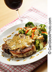 Pork chop - A pan fried pork chop served with coconut sauce...