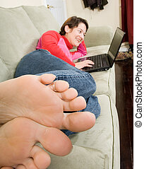 feet - casual laptop surfing with feet in forground