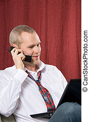 Man on the phone - businessman talking on cell phone with...