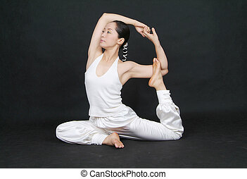 Yoga Pose - a female fitness instructor demonstrates a yoga...