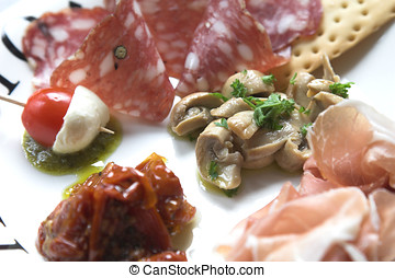 Plate of antipasti, famous Italian appetizer, with cherry...