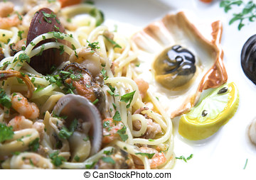 Closeup of seafood dish with mussels, squid and shrimp in...