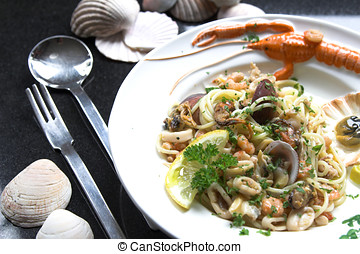 Seafood dish - Delicious seafood dish with special fork and...