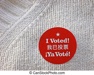 I Voted - Bright red I Voted sticker on cream colored...