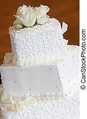 Wedding Cake - a white wedding cake with neat little swirl...