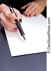 Sign Here - Close-up of hand holding pen pointing to blank...