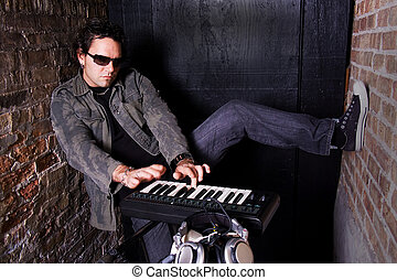 Basement Grooves - Keyboard player grooving on synthesizer...