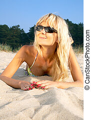 beach blond - portrait of happy blond relaxing at the beach