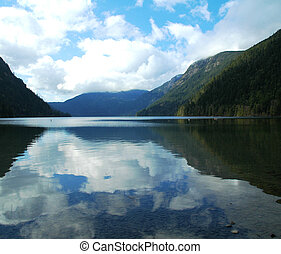 Mountain lake - A mountain lake with relfection of sky and...