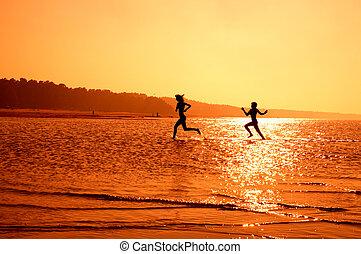 running girls 2 - silhouette image of two running girls in...